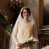 Mary poses with her bouquet of white Calla lilies in Downton. Source: PBS