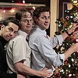 """I have no idea why Dwight's forehead says """"idiot,"""" but it makes me love this adorable tree-trimming photo even more.  Photo courtesy of NBC"""