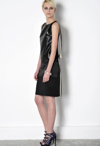 Ah, the LBD will never go out of style.  It's super modern here, with leather and a hint of white in the draped back.