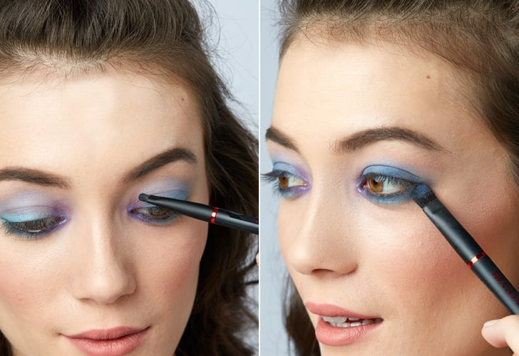 Step 2: Layer on purple and navy eye shadow for more impact
