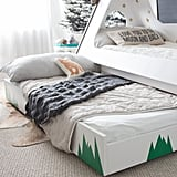 Thanks to a pull-out trundle bed, her son can enjoy sleepovers with friends once he's old enough.