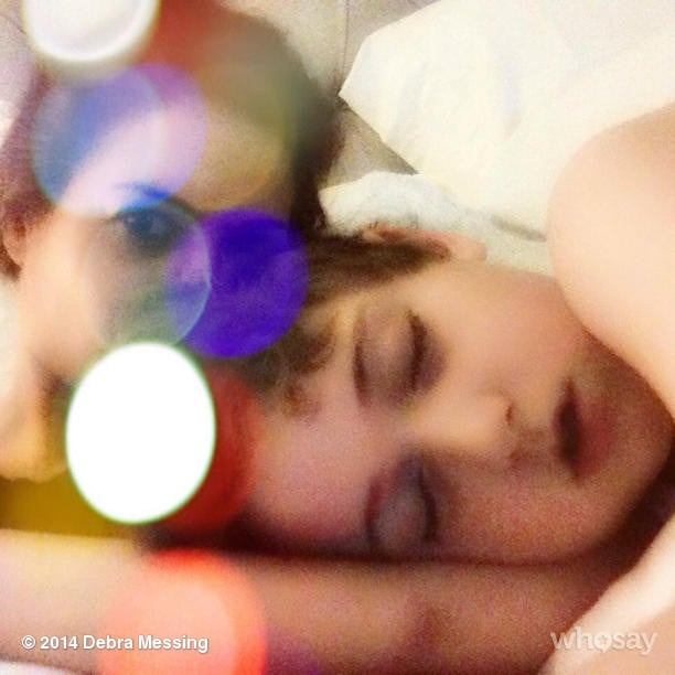 Debra Messing snuggled with a tired Roman one evening. Source: Instagram user therealdebramessing