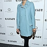 Harley Viera-Newton buttoned up in a baby-blue overcoat, black tights, and loafer-style pumps.