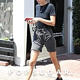 Kendall styled her mom shorts with a thick black leather belt, Yeezy x Adidas sneakers, a Re/Done bodysuit, and a Louis Vuitton coin purse while out in LA in August.