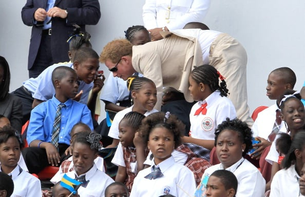 Prince Harry with children in the Bahamas.