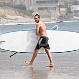 Robert Pattinson carried his paddleboard shirtless.