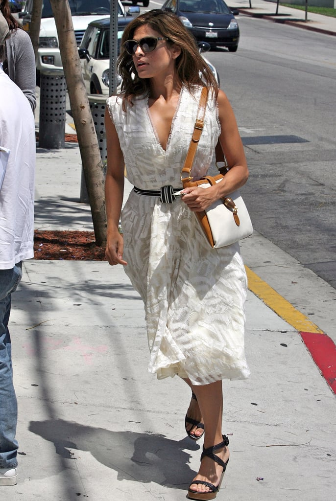Just because she's not on the red carpet doesn't mean Eva loses her chic streak. While running around LA, the actress wore a ladylike dress with wedges, cat eye sunglasses, and a two-tone bag.       Cocktail Dresses by Alexander WangSandals by Charlotte Russe