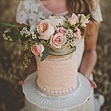 """""""What's not to adore about a boho-chic bride holding her enchanting cake in a field of wheat?"""" — Doug Weittenhiller"""