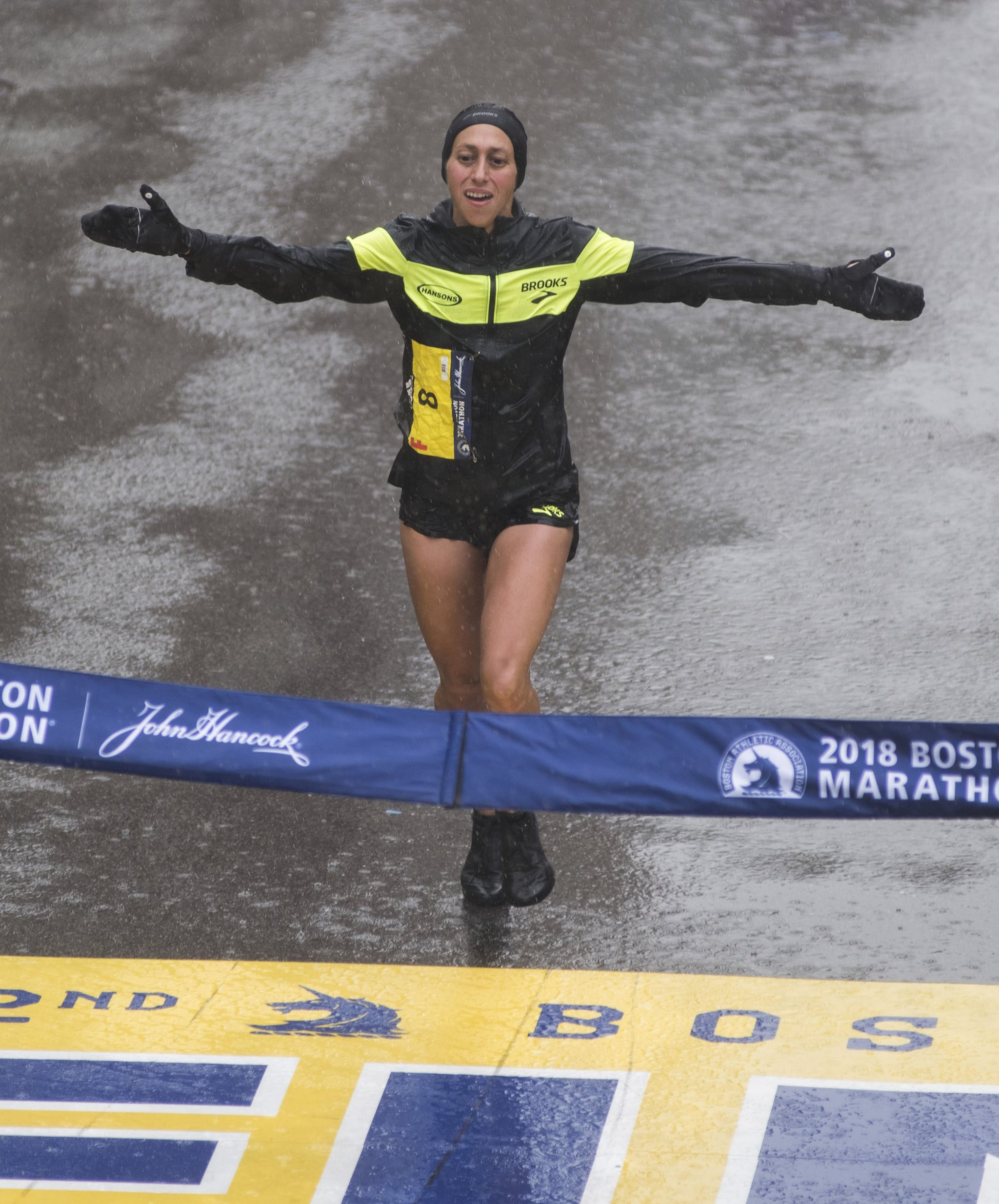 Desiree Linden of the United States crosses the finish line as the winner of the 2018 and 122nd Boston Marathon for Elite Women's race with a time of 2:39:54 on April 16, 2018 in Boston, Massachusetts. Her personal best finish was previously second place in the Boston Marathon in 2011 with a time of 2:22:38. / AFP PHOTO / RYAN MCBRIDE        (Photo credit should read RYAN MCBRIDE/AFP/Getty Images)
