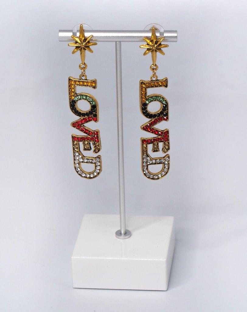 Shop Similar: Raven's LOVED Earrings