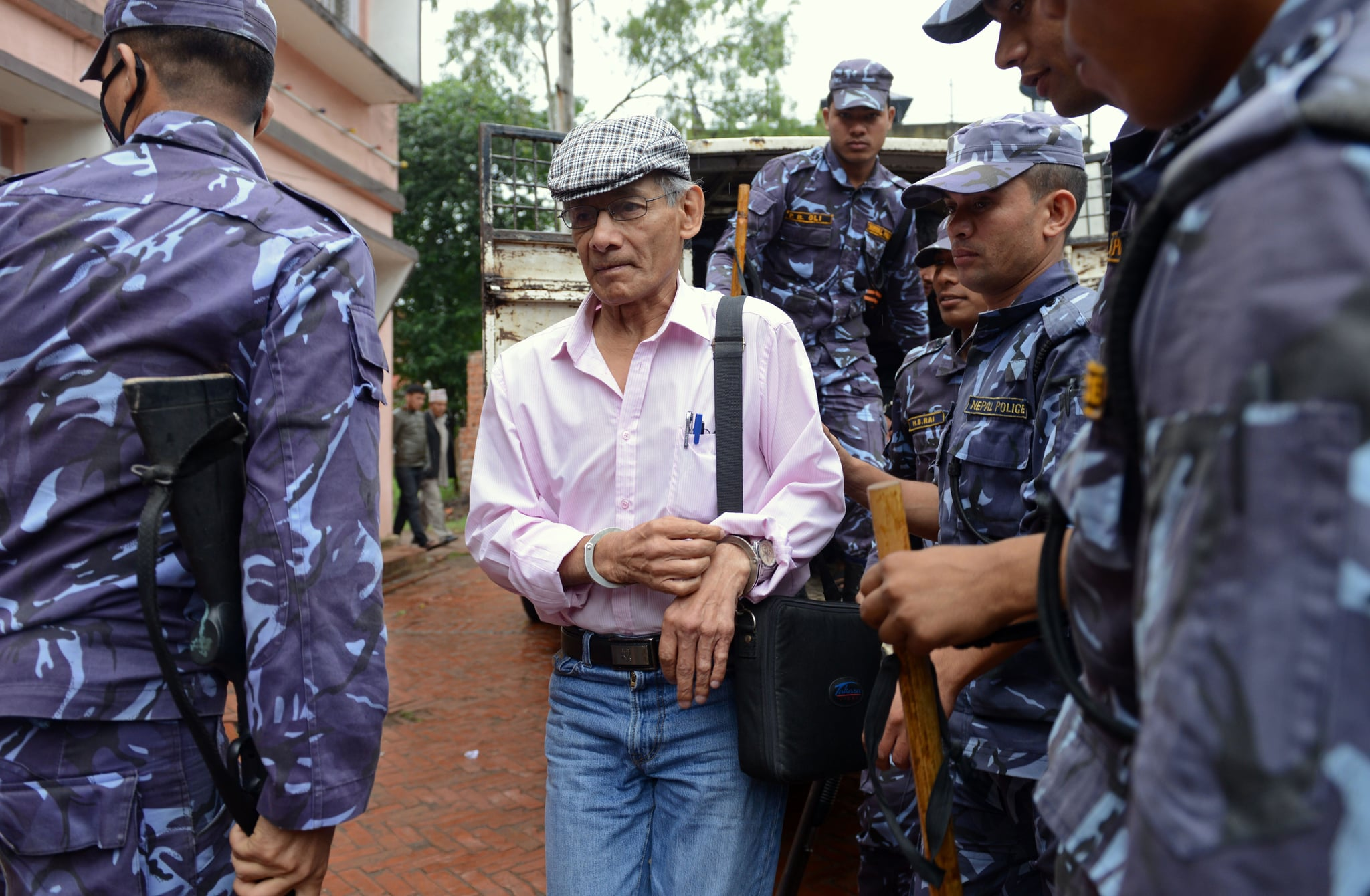 French serial killer Charles Sobhraj (C) is brought to the district court for a hearing on a case related to the murder of Canadian backpacker Laurent Ormond Carriere, in Bhaktapur on May 26, 2014. Sobhraj, a French citizen who is serving a life sentence in Nepal for the murder of an American backbacker in 1975, has been linked with a string of killings across Asia in the 1970s, earning the nickname