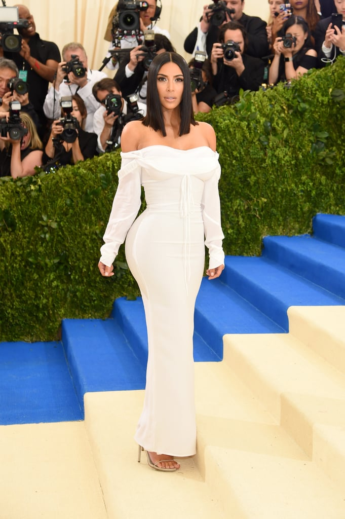 "It isn't a party without at least one of the Kardashian-Jenners present. Kim Kardashian and Kendall and Kylie Jenner attended the Met Gala in NYC. While the mom of North and Saint looked elegant in her simple white gown and minimal jewelry, her little sisters went for something a bit more flashy. Kylie wore a flapper-like number and Kendall opted for a barely there black dress. Of course, one member of the famous clan was missing during the event: Kanye West.  According to People, Kim's husband wasn't ready to return to the red carpet following his mental breakdown and hospitalization last year. ""He's not going because he's not ready to start attending big events,"" a source told the magazine. ""He's doing great but wants to keep his stress levels low and just wants to take more time off. Kim and Kanye are in a great place."" Looks like the three ladies managed to hold down the fort in his absence."