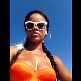 Rihanna soaked up the sun in a bright bikini and shades in July.  Source: Instagram user badgalriri