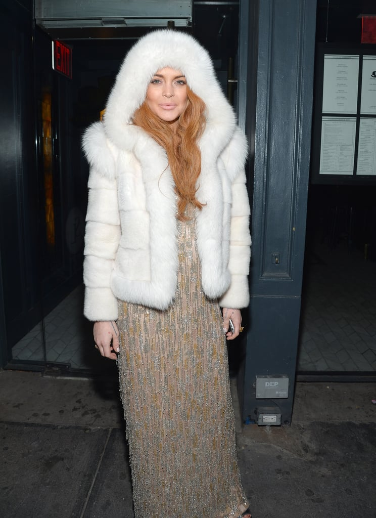 Lindsay Lohan wore white fur while waiting outside of the amfAR New York Gala afterparty in February.