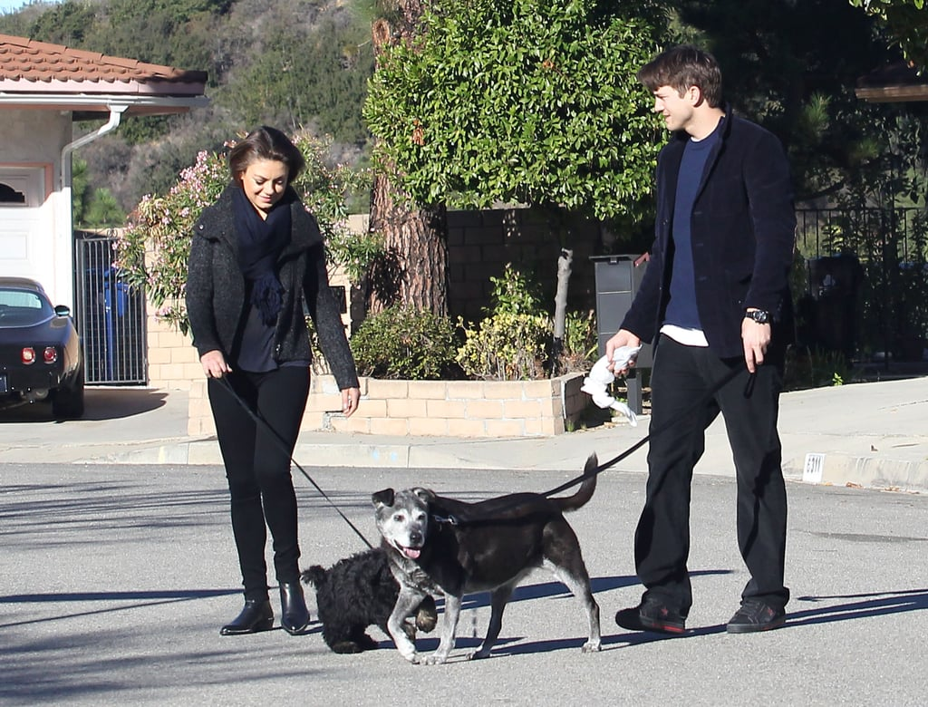 Mila Kunis spent the Monday after the Golden Globes relaxing with her man and their dogs. The actress joined Ashton Kutcher for a low-key walk with their pups in LA. On Sunday, Ashton stayed at home while Mila got glammed up for the Golden Globes, where she acted as one of the award show's presenters. While the couple didn't walk the red carpet together, they did create quite a stir earlier this month when they shared a sweet kiss while sitting courtside at a Lakers game in LA.