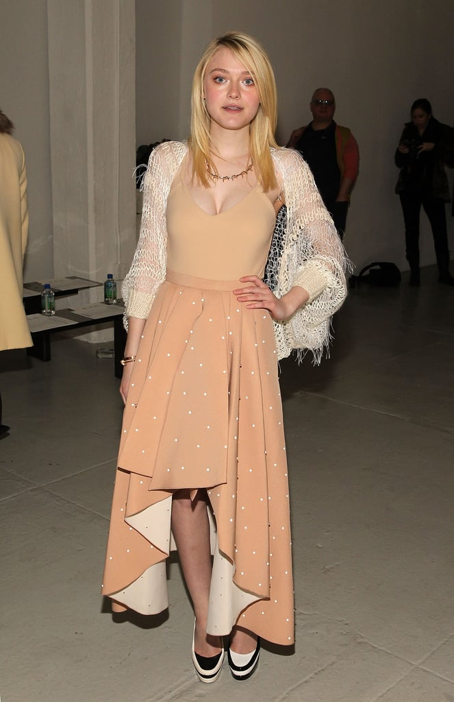 Dakota Fanning Shows Serious Skin at Fashion Week