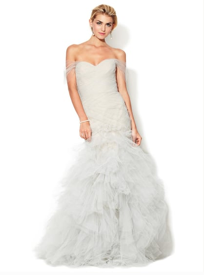 This Marchesa Couture sweetheart ruffled tulle mermaid gown ($2,499, originally $6,490) is perfect for a glamorous city wedding.
