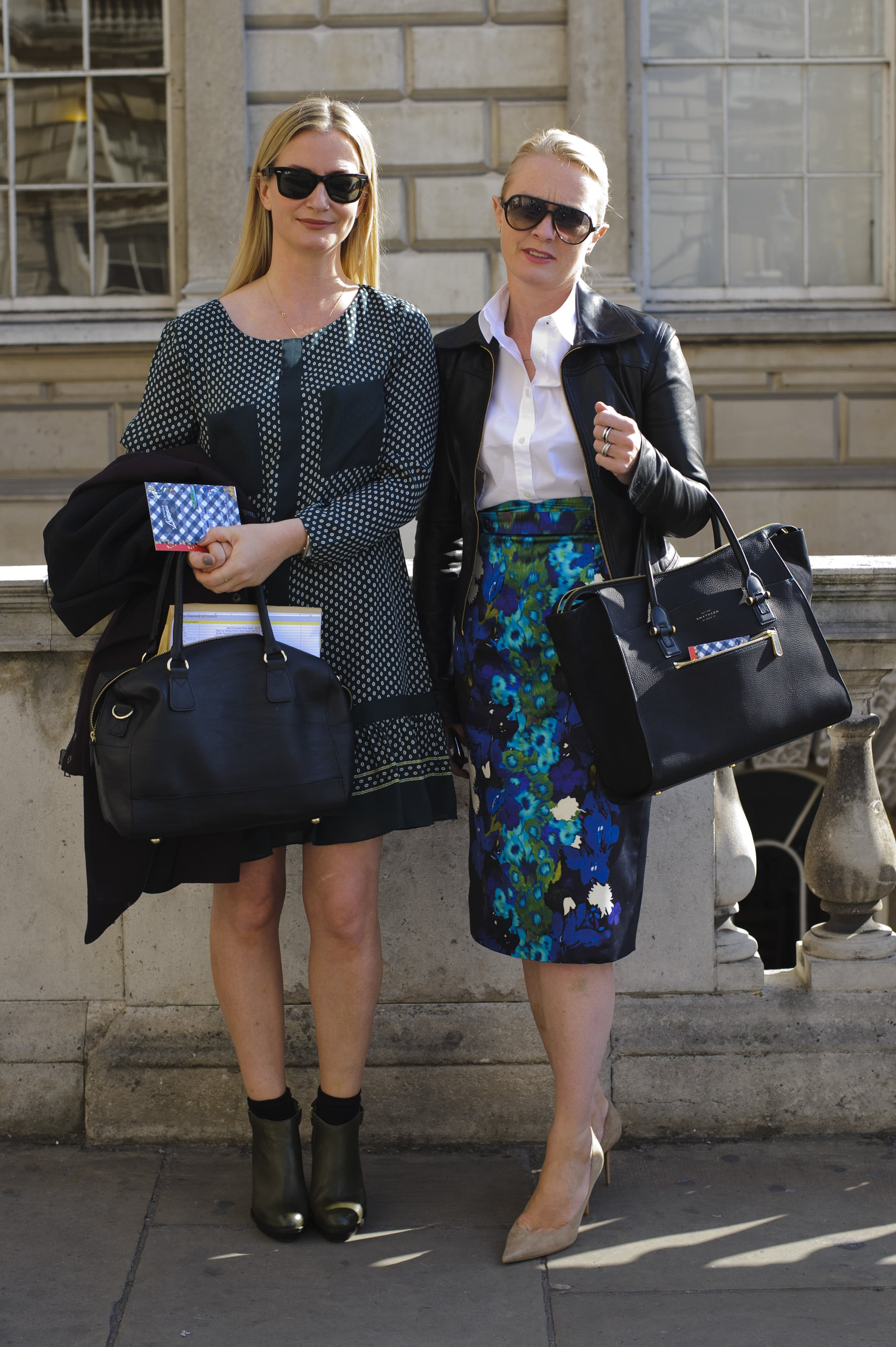 """We're feeling the """"friends who go to shows together, look chic together"""" vibe here — but the bright Erdem floral pencil skirt definitely takes first prize."""