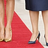 Melania and Lucy Turnbull Certainly Wore Contrasting Shoes For the Occasion