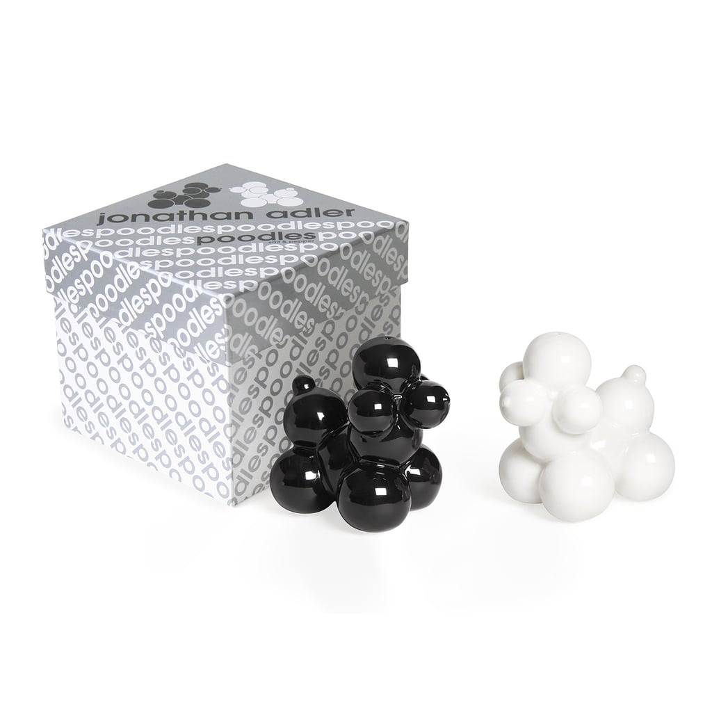 """In his handy closet of boxed gifts, Jonathan told us, """"I have some of my pepper shakers."""" We're partial to the adorable poodles salt and pepper shaker set ($48)."""