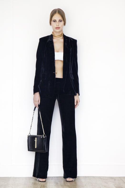 Leather Bandeau in Cream, Classic Velvet Blazer Jacket in Black, Classic Velvet Trouser in Black, Wild Night Pony Sandal in Grey Leopard, Attraction Patent Shoulder Bag in Black. Photo courtesy of Tamara Mellon