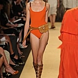 Michael Kors delivered sleek one-piece suits with sporty accents.
