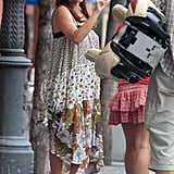 Penelope Cruz looked casual in a patterned maxi dress and sandals.