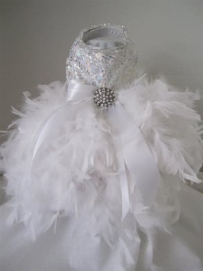 Does your pup think she's a princess? Then this Christmas Couture Snowflake Dress ($315) will make her look the part.
