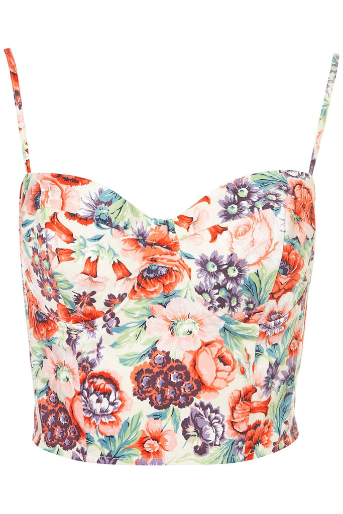 Slightly Madonna, slightly Prada, this floral corset top is sure to turn heads.  Topshop Rose Print Corset ($60)