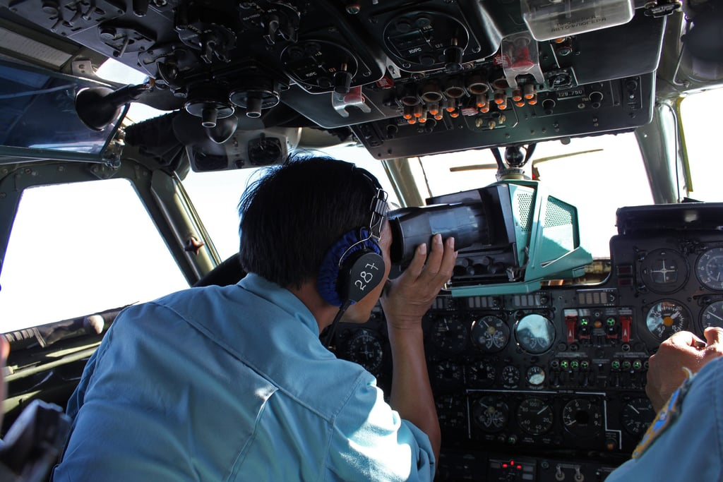 """On Saturday, military personnel aboard a Vietnam Air Force aircraft scanned the sea for wreckage and signs of the jet. The next day, Malaysia Airlines said it was """"fearing the worst"""" outcome."""