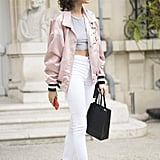 Opt for high-waisted denim and an oversize slouchy bomber and accent the combination with your accessories.