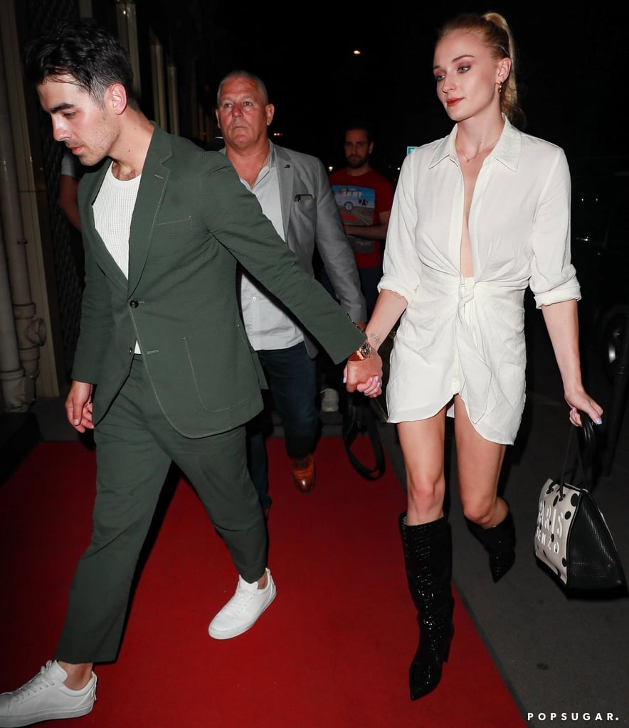 Sophie Turner in White Dress and Black Boots in Paris