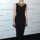 Jessica Chastain opted for a black column sheath, offset with gilded collar jewels and a pair of satin peep-toe heels.
