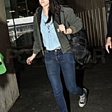 Kristen Stewart walked to her car outside a Paris airport.
