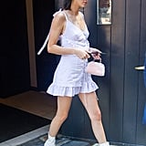 Later, Kendall went for a monochrome look by pairing her boots with a corset-clad frilled minidress.