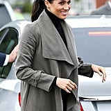 Day 13: Meghan Markle Wearing a Club Monaco Trench, Jac + Jack Knit, Outland Denim Jeans and Stuart Weitzman Boots