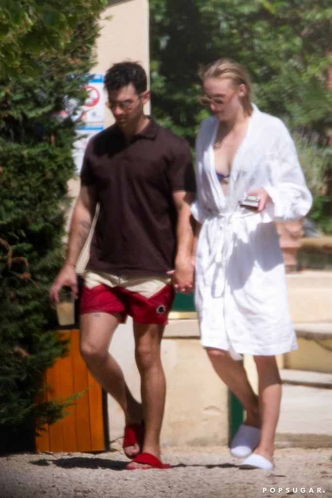 Joe Jonas and Sophie Turner's wedding day is almost here! After getting a head start on the festivities by touring around Paris, the couple arrived at their wedding venue, Château de Tourreau in Sarrians, France, on Thursday afternoon. Shortly after, the pair were joined by the rest of Joe's family, including his brothers Nick and Kevin and their respective wives, Priyanka Chopra and Danielle Jonas. The group enjoyed some cocktails before slipping into their swimsuits and relaxing by the pool. Kevin and Nick went shirtless as they soaked up the sun, while Joe covered up in a polo and swim trunks as he held Sophie's hand.  Joe and Sophie first tied the knot in May during a surprise wedding in Las Vegas. Even though they are already legally married, they plan on having an official ceremony with their families this weekend. Joe's brothers will likely serve as groomsmen, and it's possible that his niece Alena will be a flower girl. Kevin and Danielle posted a few cute photos with their 5-year-old in Paris earlier. We certainly can't wait to see all the pictures from the wedding!  Joe Jonas and Sophie Turner's wedding day is almost here! After getting a head start on the festivities by touring around Paris, the couple arrived at their wedding venue, ChIteau de Tourreau in Sarrians, France, on Thursday afternoon. Shortly after, the pair were joined by the rest of Joe's family, including his brothers Nick and Kevin and their respective wives, Priyanka Chopra and Danielle Jonas. The group enjoyed some cocktails before slipping into their swimsuits and relaxing by the pool. Kevin and Nick went shirtless as they soaked up the sun, while Joe covered up in a polo and swim trunks as he held Sophie's hand.  Joe and Sophie first tied the knot in May during a surprise wedding in Las Vegas. Even though they are already legally married, they plan on having an official ceremony with their families this weekend. Joe's brothers will likely serve as groomsmen, and it's possible that his niece Alena will be a flower girl. Kevin and Danielle posted a few cute photos with their 5-year-old in Paris earlier. We certainly can't wait to see all the pictures from the wedding!       Related:                                                                                                           Joe Jonas and Sophie Turner's First Year as Newlyweds Is Already Off to a Cool Start