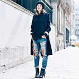 With Distressed Jeans and High Heels