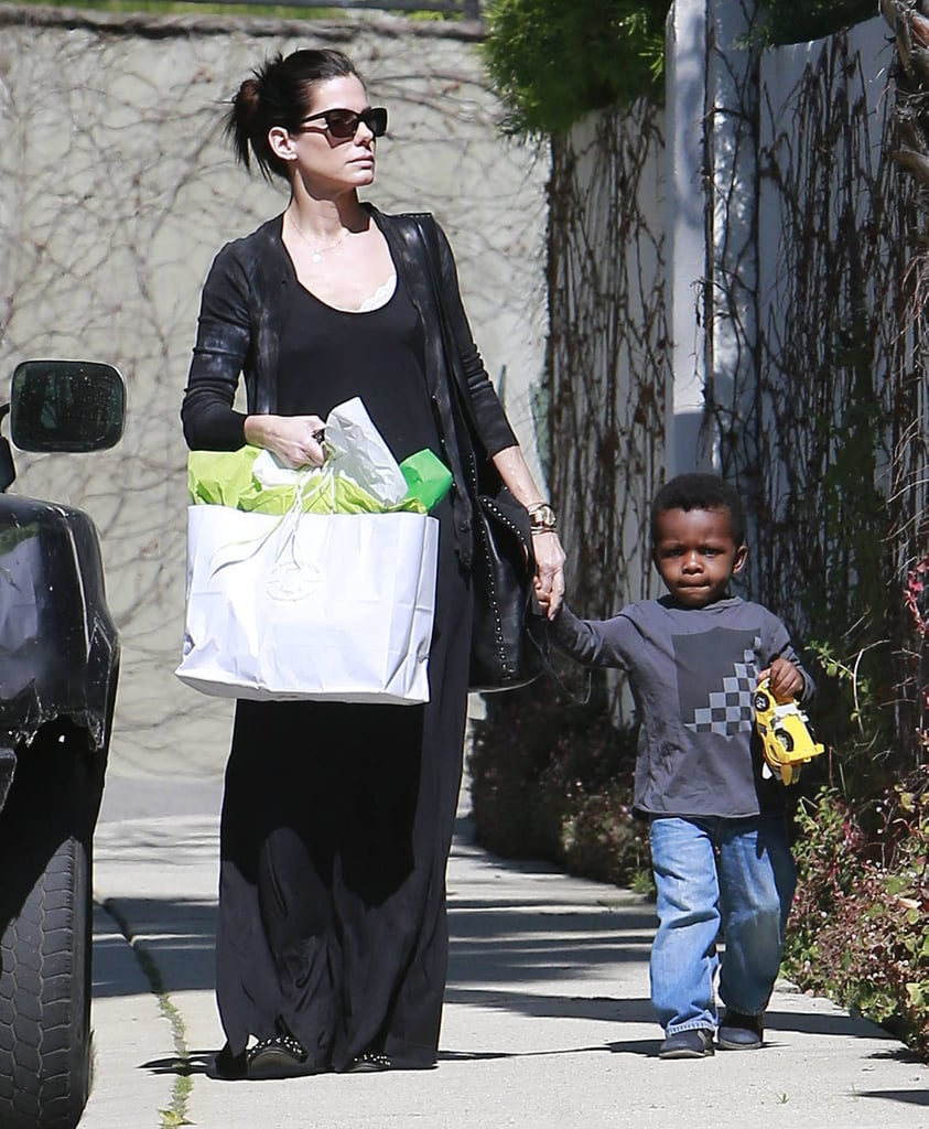Sandra Bullock took Louis to a party in LA.