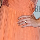 Miley wore a gorgeous round diamond on her left ring finger.