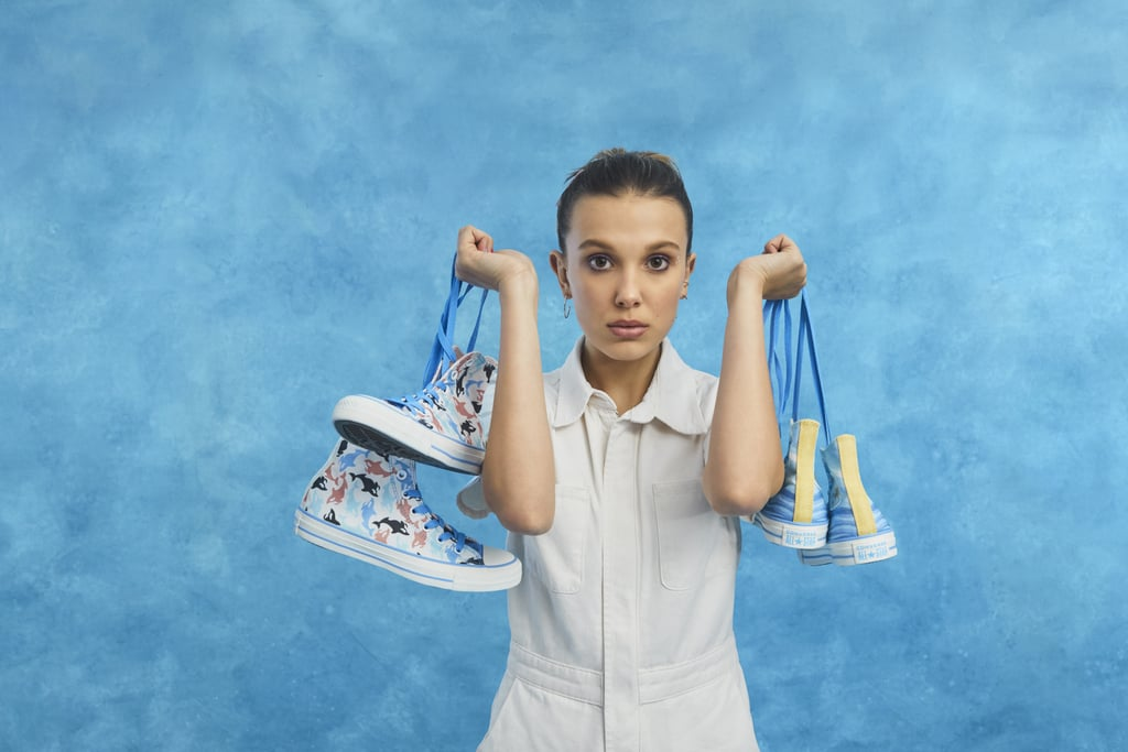 "Despite her young age, Millie Bobby Brown has been on many people's fashion vision boards since she skyrocketed to fame back in 2016, which is probably why her most recent partnership sounds like a match made in fashion heaven. The 15-year-old Stranger Things star just announced via Instagram on Monday that she's teaming up with Converse to produce a brand-new line of sneakers, making her the youngest person to ever collaborate with the brand. The Converse ""Millie by You"" line features three pairs of classic Chuck Taylor All Star sneakers that are customized with MBB's own ocean-inspired designs to show off her obsession with whales. ""To choose the colors and material and print for the shoes was really specific and special to me,"" the actress said in an Instagram post teasing the launch. In addition to that, the ""Millie by You"" sneakers will be available in styles Hi and Ox and will come in a palette of 10 colorways and prints so fans can customize each pair to their liking.  The collection will be available to build on Converse.com on July 11, but you can catch a small peek at what to expect from the lineup ahead.      Related:                                                                                                           35 Times Millie Bobby Brown's Instagram Reminded Us She's Just Really Cool"