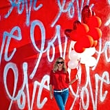 She posed in front of this vibrant backdrop with a handful of balloons, because who wouldn't?
