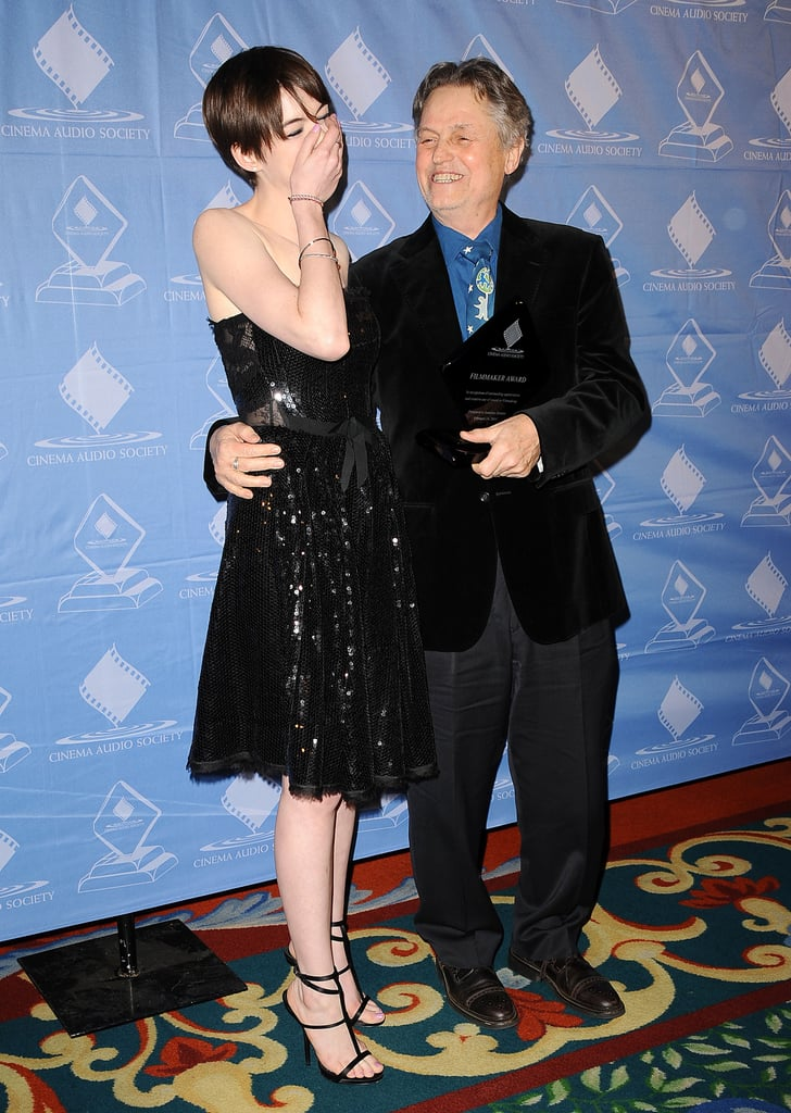 Anne Hathaway had the giggles at the Cinema Audio Society Guild Awards with Jonathan Demme.