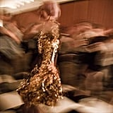 Katie Shillingford in Fall 2011 Gareth Pugh gold dress
