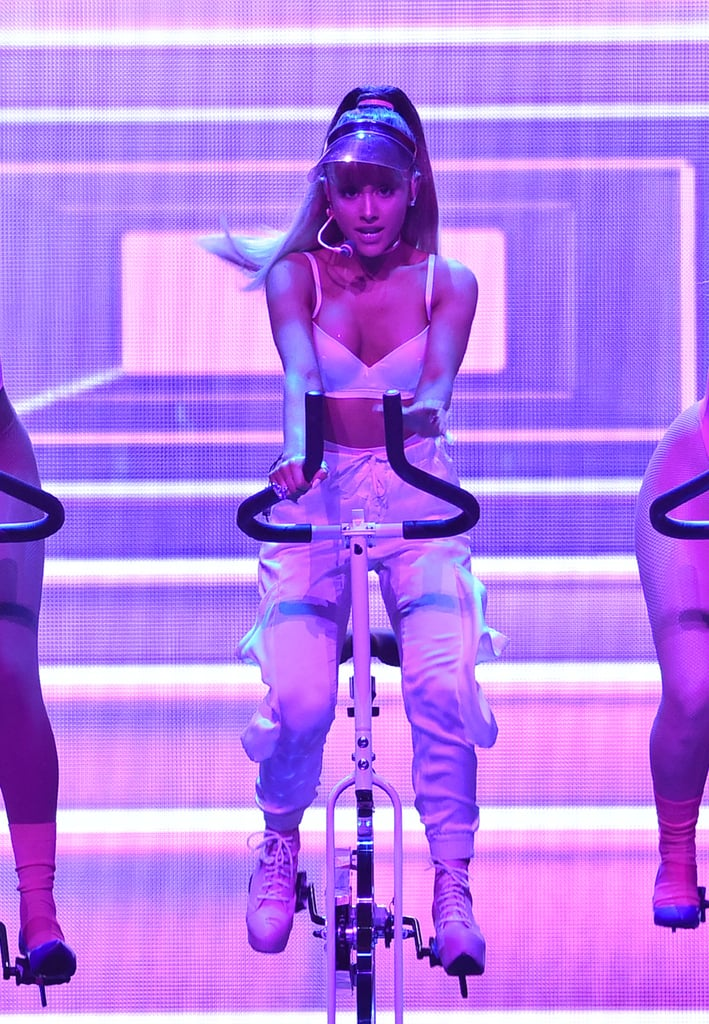 """Ariana Grande is back and better than ever! The 23-year-old star took the stage on Sunday night to perform her hit """"Side to Side"""" with Nicki Minaj at the MTV Video Music Awards, where she did some incredible things . . . and by incredible, we mean leading an awesome indoor cycling class on stage.  Ariana sang alongside her backup dancers on stationary bikes, turning Madison Square Garden into the brightest gym in New York City, and she looked flawless the whole time. Nicki came out to the stage surrounded by gorgeous men lifting weights. Seriously, where do we sign up for their class? Check out all the photos from Ariana and Nicki's performance and get inspired for your workouts for the week!      Related:                                                                VMAs Style Hasn't Changed Since Your Childhood, and These Pics Are Proof                                                                   12 Things You Never Knew About SoulCycle, From an Instructor                                                                   Celebrity Couples Use the MTV VMAs as Their Ultimate Sunday Date Night                                                                   Watch All of Rihanna's Performances From This Year's VMAs"""