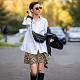 A white button-down shirt elevates a printed miniskirt for work.