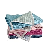 In the same style of Serena & Lily's popular Cabin Quilt, the pint-size Mini Cabin Quilt ($88) features contrasting stitching and a puckered texture. Plus it's fully reversible and comes in four fun colorways.
