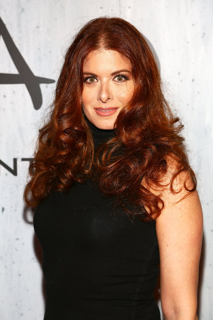 Bringing on the drama with voluminous curls and lush lashes, Debra Messing stuck to a warm neutral palette that's perfect for Fall.