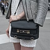 A Proenza Schouler bag added cool-girl appeal to tweed.