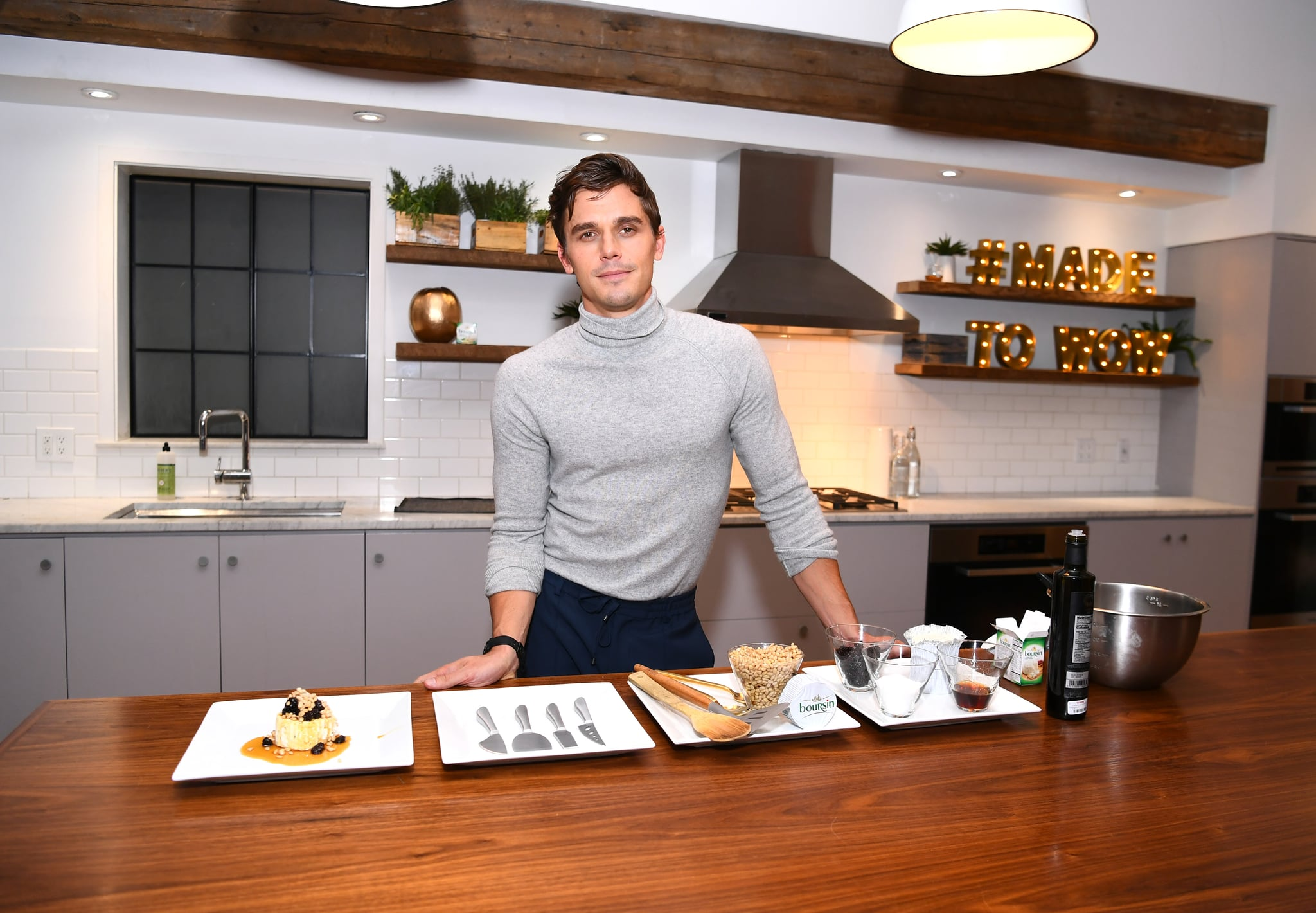 NEW YORK, NY - NOVEMBER 07:  Antoni Porowski demonstrates preparing a signature dish as he attends Boursin Friendsgiving at Home Studios on November 7, 2018 in New York City.  (Photo by Dave Kotinsky/Getty Images for Boursin Cheese)